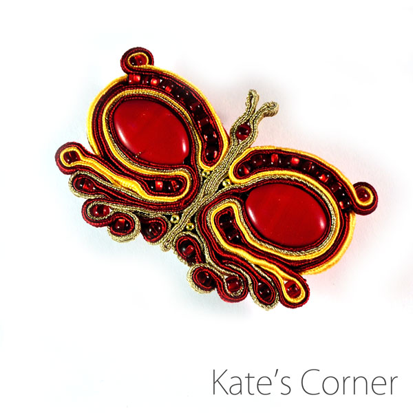 Red butterfly brooch