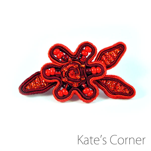 Small red flower brooch