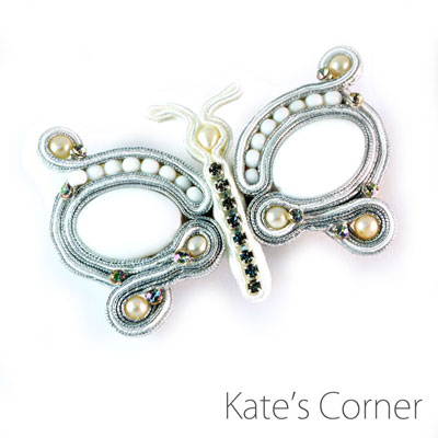White butterfly brooch