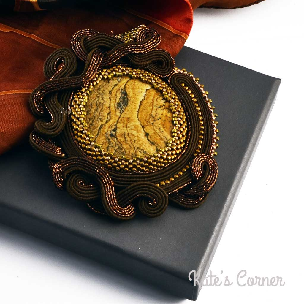 Landscape jasper in a brown soutache