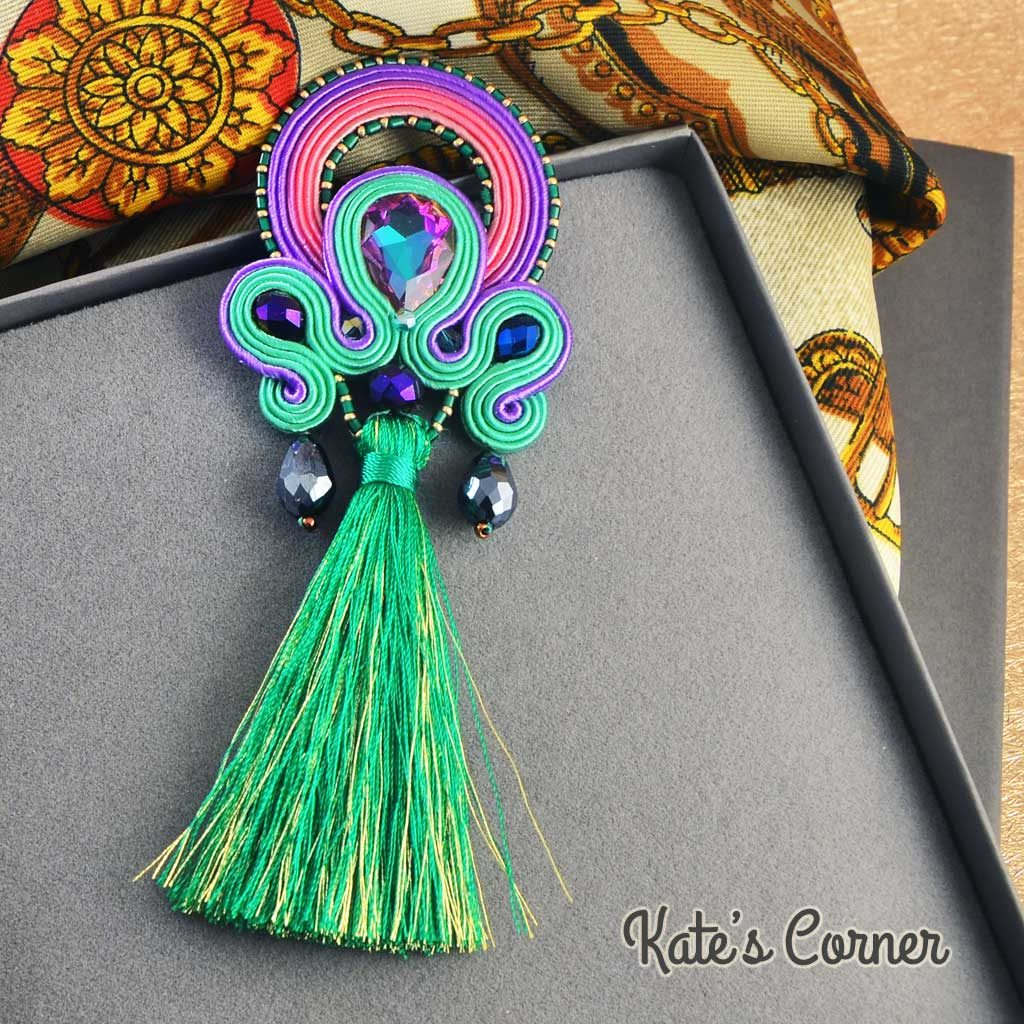 Purple-green pendant with crystal