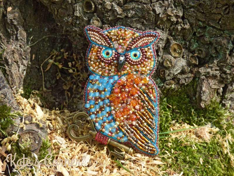Blue owl brooch