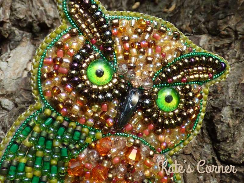 Green owl brooch