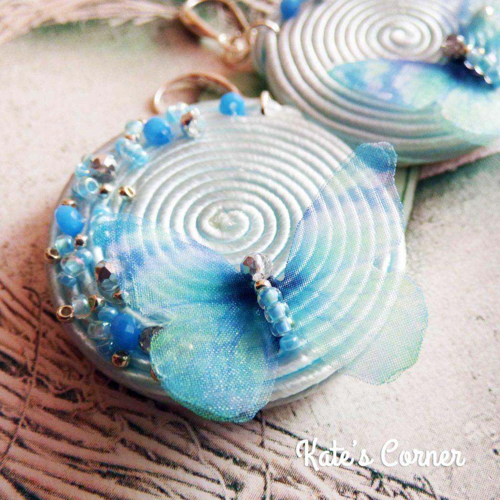 Light blue butterfly earrings